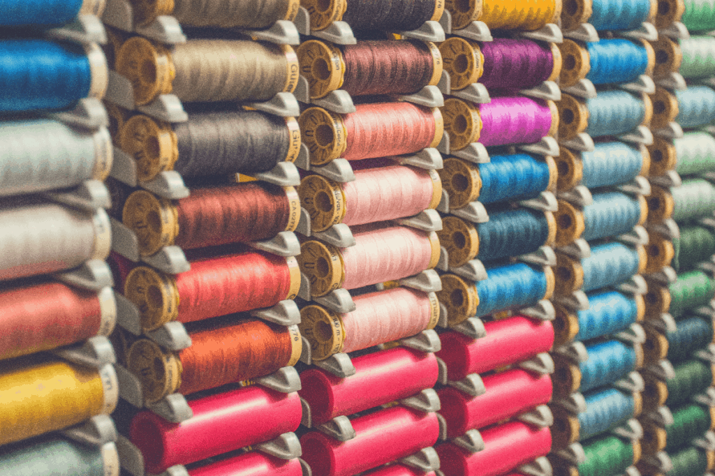 reels of multi-colored cotton on rack