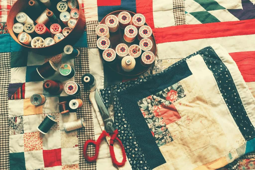 quilt with thread and scissors