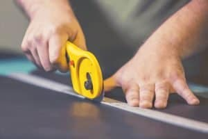 Close up of man's hands using Rotary Cutter