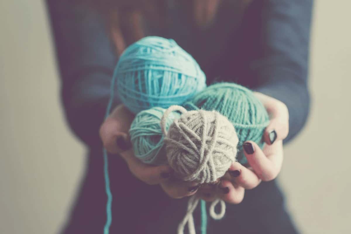 Woman holding balls of yarn