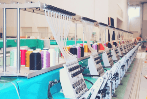 row of commercial embroidery machines