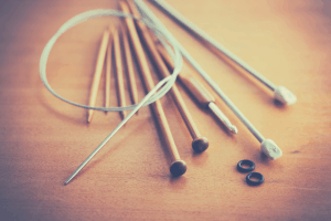 knitting needles on wooden table