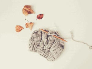 partially knitted hat with autumn leaves